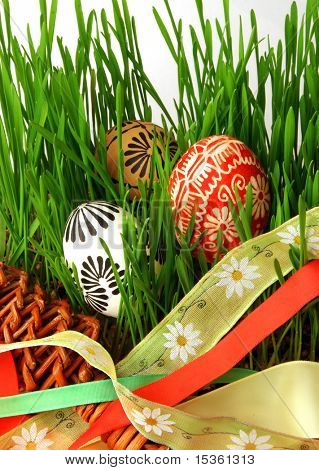 Easter eggs, ribbons and grass