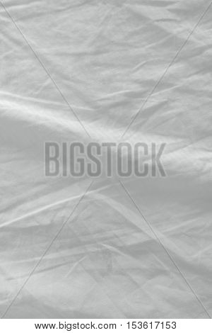 Used bed sheets texture clean white crumpled cotton material surface