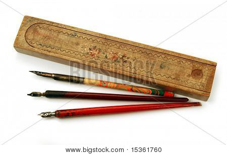 Vintage pens and wooden pen-case, isolated