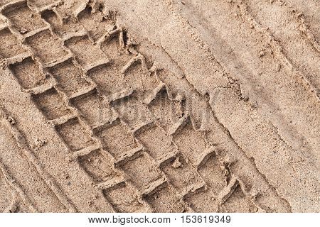 Tire Track Over Wet Sand