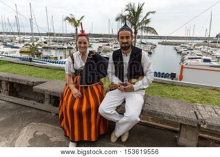 FUNCHAL MADEIRA PORTUGAL - SEPTEMBER 1 2016: Portrait of a couple in traditional costume in Funchal on Madeira. Portugal