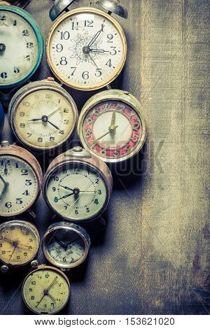 Old clocks in pile, concept made of old clocks and watches