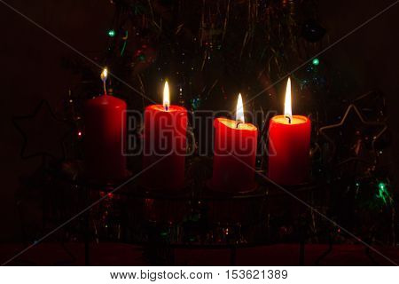 4. Advent / Advent wreath on dark background. Postcard.