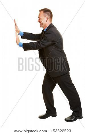 Isolated full body manager pushing imaginary wall to the side
