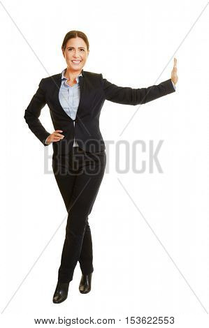 Smiling isolated fully body businesswoman leaning on imaginary wall