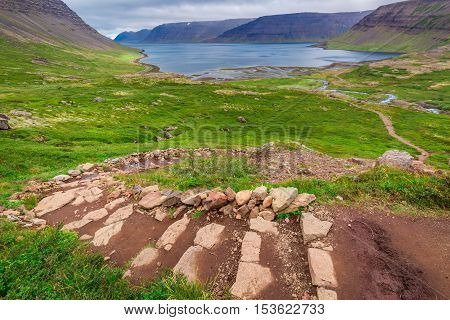 Footpath to waterfall Dynjandi in Iceland in summer