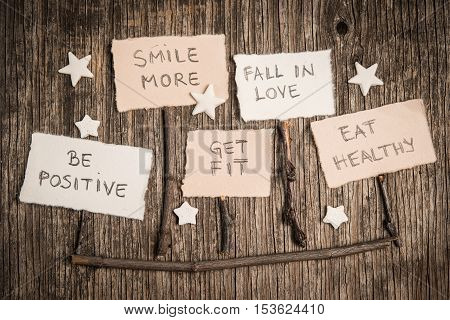 New Year's resolutions messages over rustic wood