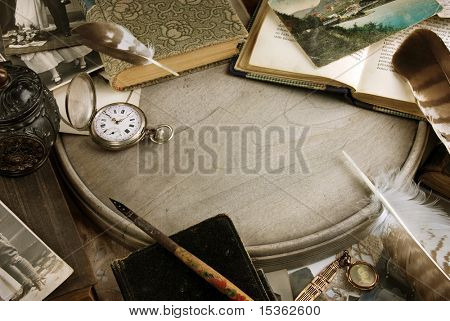 Vintage composition with books and pocket clock