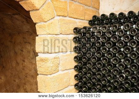 Bottles with wine in cellar