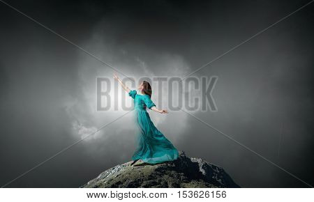 Fantasy woman on rock top . Mixed media
