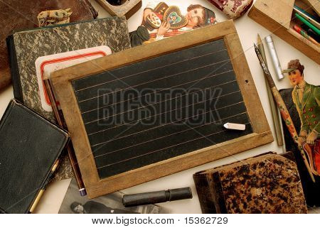 Old small blackboard and other vintage children objects