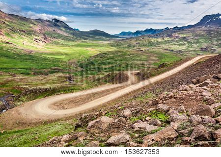 Winding Mountain Road Leading To The Valley In Iceland