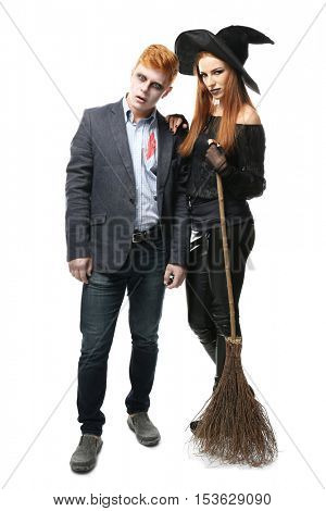 Young people dressed as dead man and witch for Halloween party, isolated on white