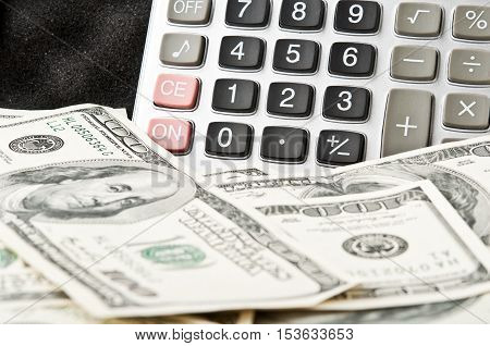 Calculator And Many Dollars