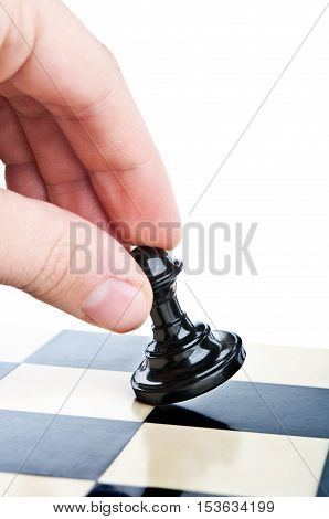 Hand And A Chess Pawn On The Board