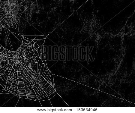 Spider web silhouette against black shabby wall - halloween theme spooky background with place for your text