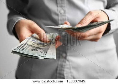 Woman holding money in hands