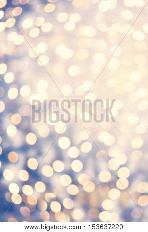 Abstract twinkled bright background with natural bokeh defocused lights. Glitter vintage lights