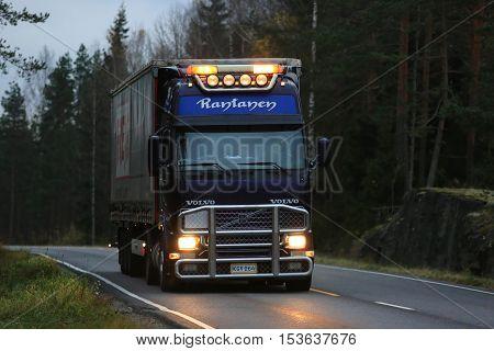 SALO, FINLAND - OCTOBER 23, 2016: Purple Volvo FH semi trailer truck of JR-Trans hauls cargo trailer along road late in the evening.