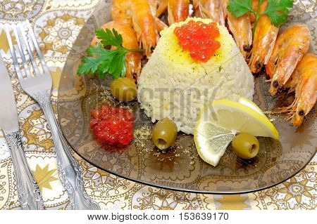 steamed rice with red caviar and fried shrimp close-up. horizontal photo.