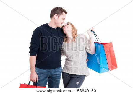 Couple Holding Shopping Bags And Smiling