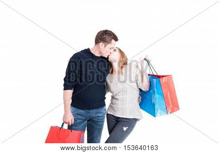 Couple Holding Shopping Bags And Kissing