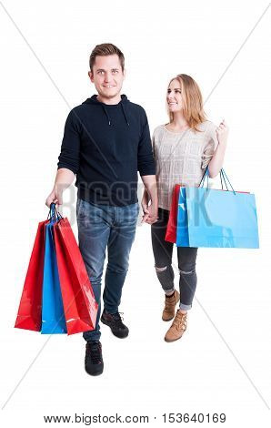 Happy Couple Holding Bunch Of Shopping Bags