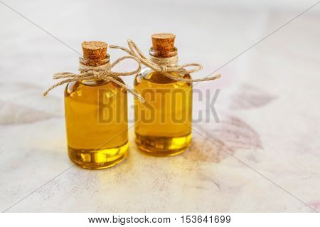 Olive Oil In Small Bottles White Background