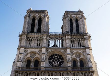 Western facade of Notre Dame Cathedral in Paris France