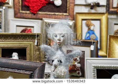 Vilnius Lithuania - December 27 2015: Stall with handmade dolls on the Christmas Market in Vilnius in Lithuania.