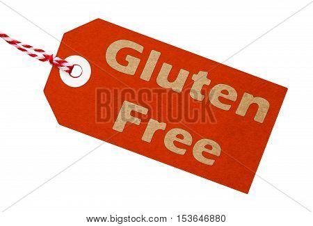 Gluten free label made from red cardboard with string on an isolated white background
