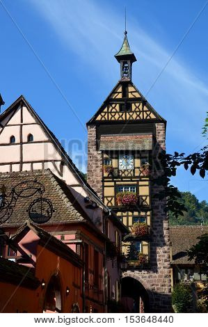 Riquewihr, Elsass, France - OCTOBER 16. The Dolder is a medieval tower in Riquewihr, Alsace and the landmark of the village. The Dolder was built in 1291 as the western end of the fully preserved Riquewihr fortification. on October 16, 2016.