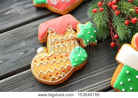 Tasty gingerbread cookies on wooden background, close up