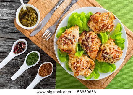 Delicious Stuffed Chicken Breast On White Dish