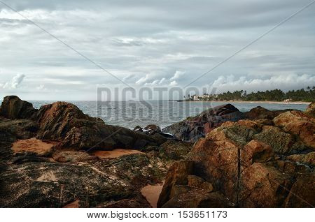 Large rocks on the background of the ocean with an island