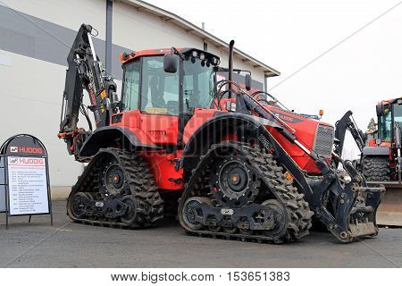 LIETO FINLAND - MARCH 12 2016: Huddig 1260C Muddy Mary four track backhoe loader seen at the public event of Konekaupan Villi Lansi Machinery Sales.