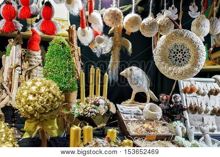 Handmade bird figurine, wreaths and other souvenirs displayed for sale at the Christmas market in old Riga Latvia. Selective focus