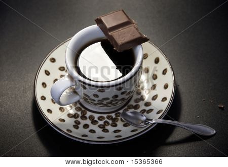 Coffee with chocolate. Dark background.