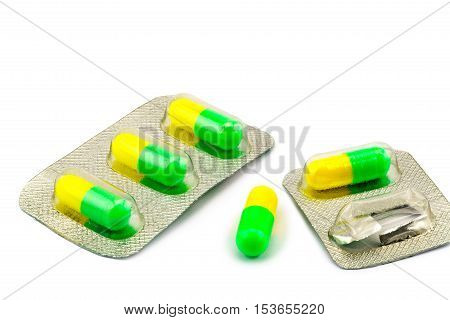 Capsule of antibiotic and packages on white background
