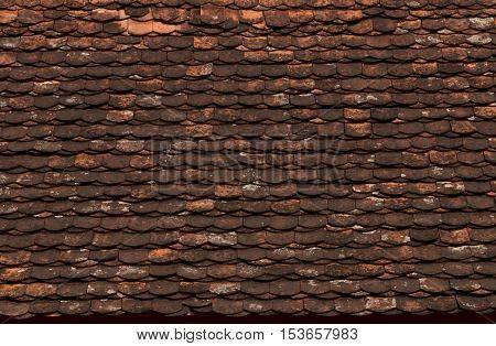Old hand made roof made from red wood wooden roof.