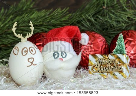 Santa Claus and Christmas deer on New year and Christmas .Unusual eggs with the faces ,muzzle.Christmas cartoon, decorations.