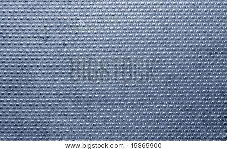Geribde metalen textuur. Blauwe tint.