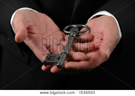 Hands Holding Key