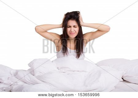 Portrait of young female in the morning with alarm clock. Woman does not want to wake up. Isolated.
