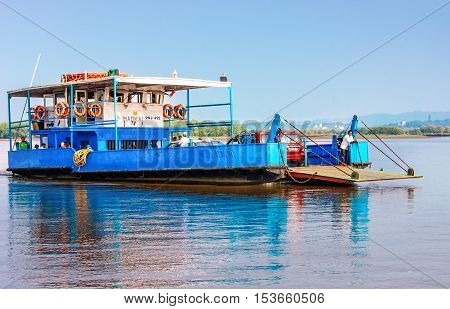 Goa, India - November 13, 2012: Ferry arriving to Chorao island in Salim Ali Bird Sanctuary Goa India. Ferries is the only means of transport across the many rivers of India as there is no bridge