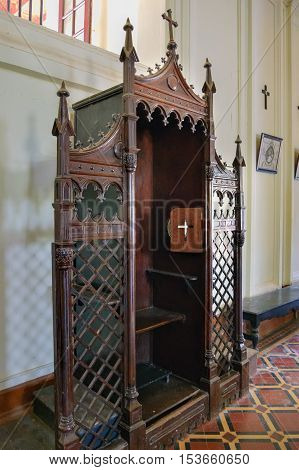 Old Goa India - November 13, 2012: Wooden Confessional in Basilica of Bom Jesus or Borea Jezuchi Bajilika Old Goa. Basilica - UNESCO World Heritage Site and functioning church.