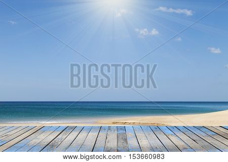 Wood floor with Andaman sea beach and tropical sea scenery background