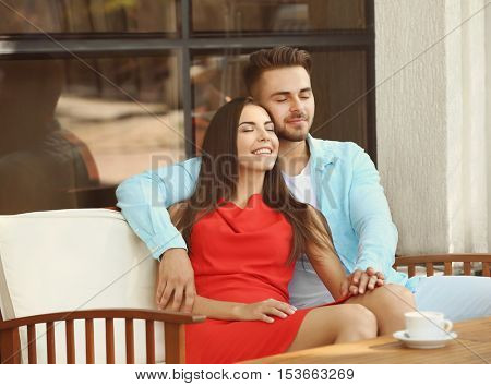 Happy lovely couple in cafe