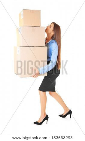 Beautiful businesswoman holding heavy boxes on white background
