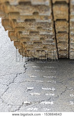 Tank Caterpillar Traces on the Cracked Asphalt